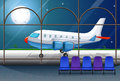 Airport scene with airplane parking at night Royalty Free Stock Photo