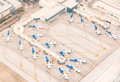 Airport scene ariel view of with planes lined up at terminals remote parking taxiways runways and airplanes ready to depart Royalty Free Stock Image
