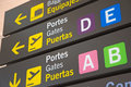 Airport signs in english and spanish language Royalty Free Stock Images