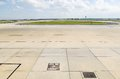 Airport tarmac view of and aircraft and freight parking bays Royalty Free Stock Photography