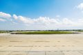 Airport tarmac view of and aircraft and freight parking bays Royalty Free Stock Images