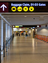 Airport terminal hallway and direction sign Royalty Free Stock Photo