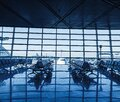 Airport terminal interior with rows of empty seats Royalty Free Stock Photo