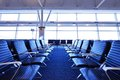 Airport terminal seats empty at an Royalty Free Stock Image