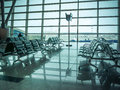 Airport waiting area , seats and outside the window scene Royalty Free Stock Photo