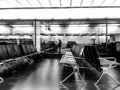 Airport waiting lounge empty chairs at night Stock Images