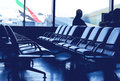 Airport waiting lounge scene with people to embark Royalty Free Stock Image