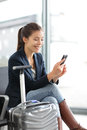 Airport woman on smart phone at gate - air travel Stock Image