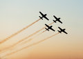 Airshow planes in formation star leaving smoke trails over sky Royalty Free Stock Photography