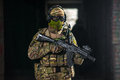 Airsoft strikeball player in military soilder Royalty Free Stock Photo