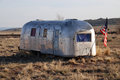 Airstream trailer abandoned old fashioned caravan seen in the arizona desert next to route in seligman Royalty Free Stock Images