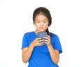 Aisan chil dren to using smart phone half body asian teen standing and on white background Stock Image