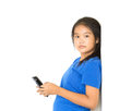 Aisan chil dren to using smart phone half body asian teen standing and on white background Royalty Free Stock Photos