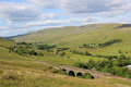 Aisgill viaduct and view down mallerstang valley looking northeast from the lower slopes of swarth fell past on the settle to Royalty Free Stock Photos