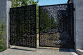 Ajar latticed steel gate of yard under consturction partially opened a construction Royalty Free Stock Image