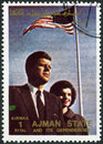 AJMAN - 1972: shows John F. Kennedy (1917-1963) and wife Jacqueline Lee Jackie Bouvier (1929-1994) Royalty Free Stock Photo