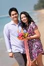 Ajouter au bouquet de fleur sur la plage Photographie stock libre de droits
