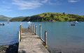 Akaroa jetty canterbury new zealand picturesque on the foreshore of the tourist town of Stock Images