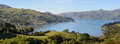 Akaroa town panorama new zealand panoramic view of township one of s most popular tourist and cruise boat destinations Royalty Free Stock Photos