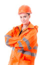 Akimbo simple woman in working clothes on a white background Royalty Free Stock Photos