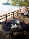Al fresco seaside dining table & cutlery setting Royalty Free Stock Photo