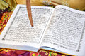 Al qur an with cinnamon the muslim holy book Stock Images