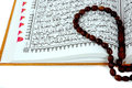 Al Quran and prayer beads Stock Photos