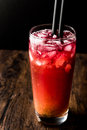 Alabama Slammer Cocktail with black straw. Royalty Free Stock Photo