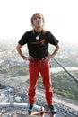 Alain Robert on top of skyscraper Royalty Free Stock Photo