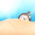 Alarm clock on the beach studio shot Stock Image