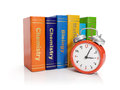 Alarm clock and books Stock Photos