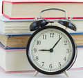 Alarm clock on books background Royalty Free Stock Photo