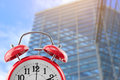 Alarm clock with building in urban Royalty Free Stock Photo
