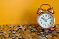 Alarm clock and coins Royalty Free Stock Photography