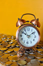 Alarm clock and coins Royalty Free Stock Photo