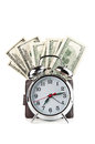 Alarm clock and dollars Stock Images