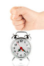 Alarm clock and a fist Royalty Free Stock Images