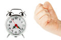 Alarm clock and a fist Royalty Free Stock Photos