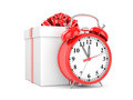 Alarm clock and gift box Royalty Free Stock Images