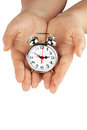 Alarm clock with hands Royalty Free Stock Photo