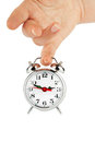 Alarm clock with hands Royalty Free Stock Photos