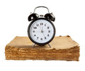Alarm clock on old book softcover isolated over white Royalty Free Stock Image