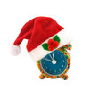 Alarm clock with Santa hat isolated over white. Royalty Free Stock Photo