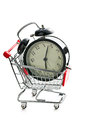 Alarm clock in shopping cart on white background Royalty Free Stock Photos