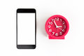 Alarm clock and smart phone on white background. Royalty Free Stock Photo