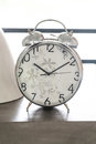 Alarm clock on table in th room interior Stock Photo