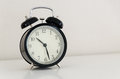 Alarm clock watch on vintage background Stock Photography