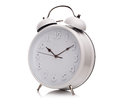 Alarm clock with white face isolated Stock Images