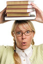 Alarmed Woman Carries Stack of Books on Head Stock Photo