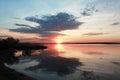 Alarming sunset near the water in belarus Stock Photos